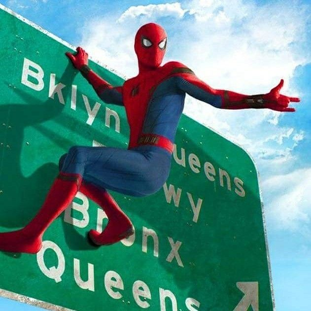 a new photo from spider man homecoming has arrived online features spidey in a rather unlikely situation for the webslinger hitching a ride on a truck